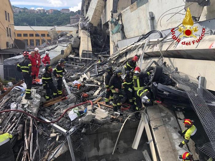 A handout photo made available by Italian firefighters shows rescue teams on the site of a collapsed bridge over the A10 highway in Genoa, Italy, 14 August 2018. A large section of the Morandi viaduct upon which the A10 motorway runs collapsed in Genoa on early 14 August. Several people have died, rescue sources said, as both sides of the highway fell. The viaduct gave way amid torrential rain. ANSA/ITALIAN FIREFIGHTERS HANDOUT +++ ANSA PROVIDES ACCESS TO THIS HANDOUT PHOTO TO BE USED SOLELY TO ILLUSTRATE NEWS REPORTING OR COMMENTARY ON THE FACTS OR EVENTS DEPICTED IN THIS IMAGE&#59; NO ARCHIVING&#59; NO LICENSING +++